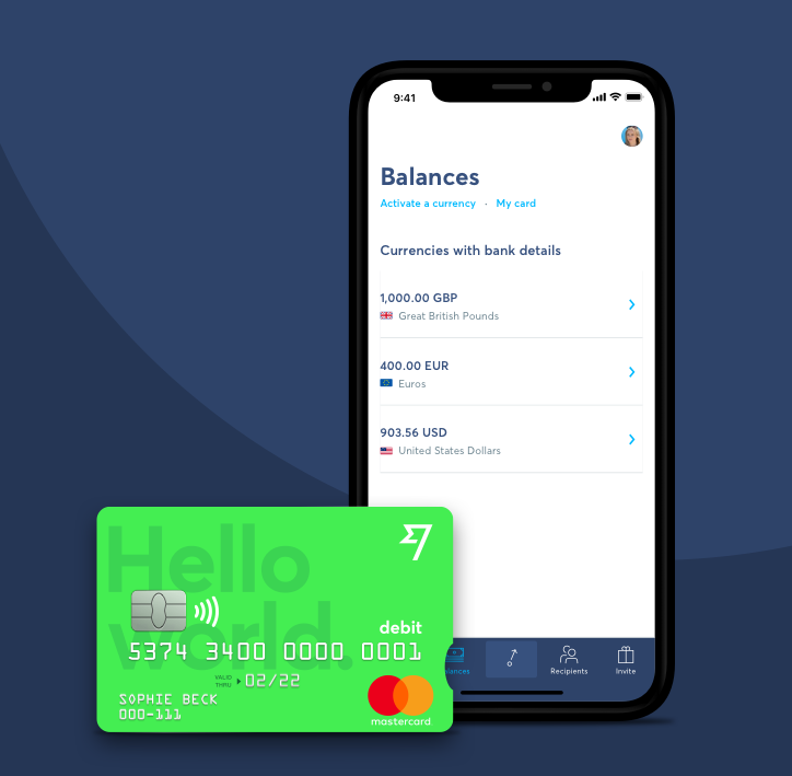 Wise mobile app pictured on a smartphone with a green Wise debit card just in front.